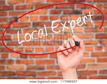 Man Hand Writing  Local Expert With Black Marker On Visual Screen