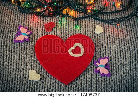 Small White Decorative Heart On A Red Felt Heart