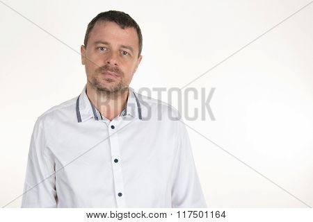 Elegant Handsome Man In White Shirt. Studio Fashion Portrait.
