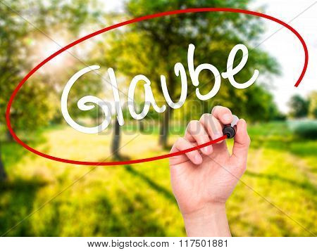 Man Hand Writing Glaube (believe In German) With Black Marker On Visual Screen.