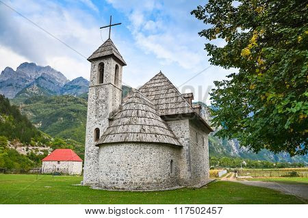 Ancient Stone Church In A Mountain Village