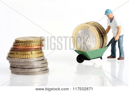 Miniature Worker Drives Euro Coins