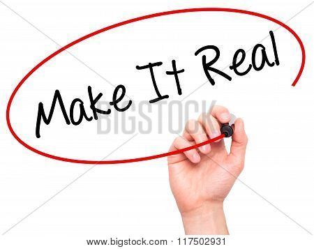 Man Hand Writing Make It Real With Black Marker On Visual Screen.