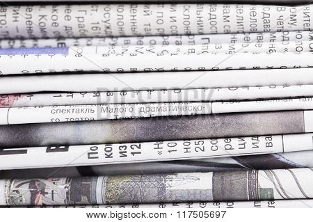 stack of newspapers closeup background