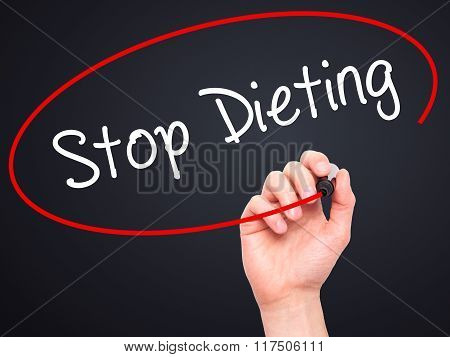 Man Hand Writing Stop Dieting With Black Marker On Visual Screen.