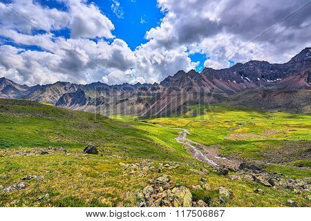 Alpine Meadows In The Mountain Valley
