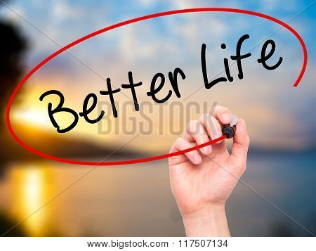 Man Hand Writing Better Life With Black Marker On Visual Screen.