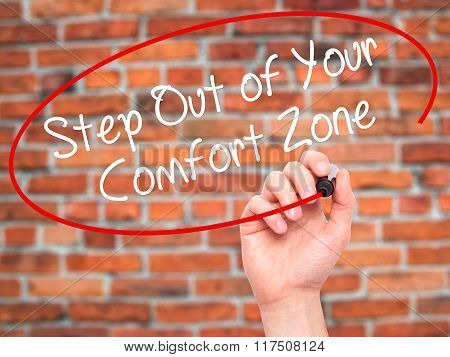 Man Hand Writing  Step Out Of Your Comfort Zone With Black Marker On Visual Screen.