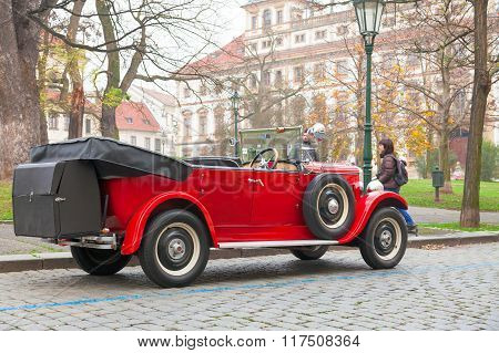 CZECH REPUBLIC, PRAGUE, 29 NOVEMBER,2014:Red veteran car on the street is parking on public roads.