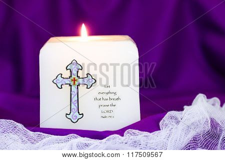 Candle with bible verse on purple cloth