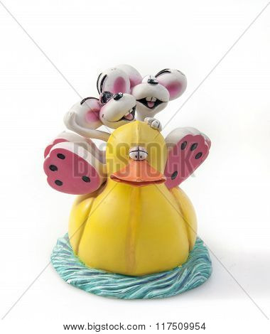two rabbits ride a duck on water toy isolated white