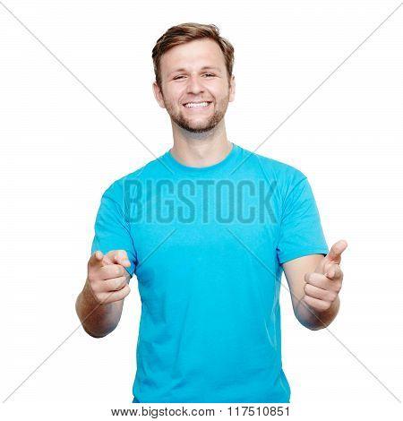 Smiling young man pointing at camera
