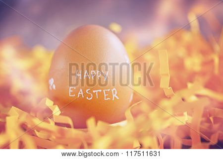 Brown Easter Egg With Text Happy Easter On Yellow  Background
