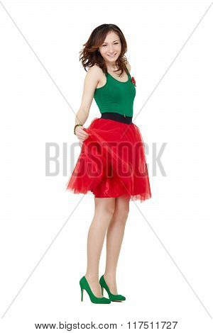 Dancing teenage girl wearing red dress
