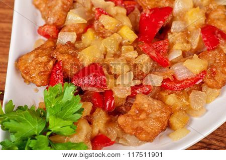 stewed potatoes with tomato, closeup food