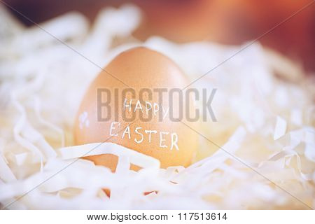 Brown Easter Egg With Text Happy Easter. Toned Image