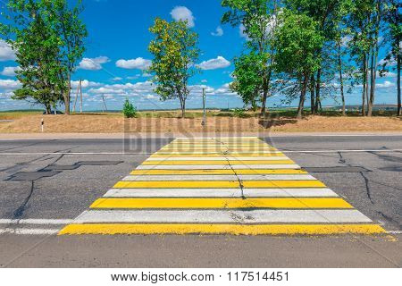Empty Country Highway With A Pedestrian Crossing