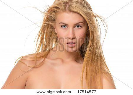 Young blond woman looking at the camera. Closeup
