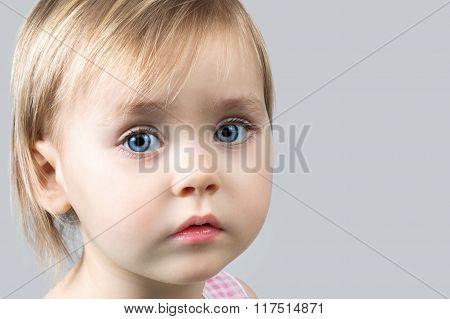 Close-up Portrait Of A Beautiful  Little Girl