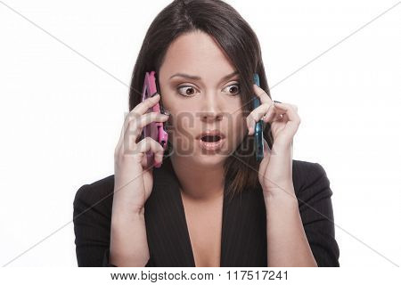 young woman listening two cell phones at once