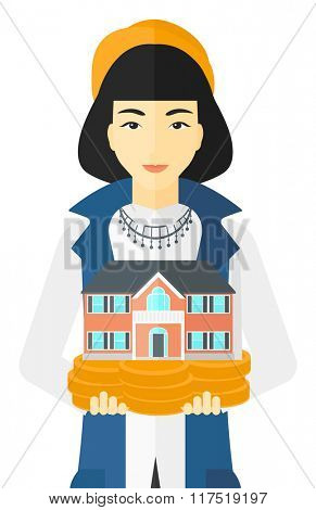 Woman holding house model.