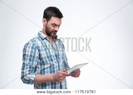 Portrait of a man using tablet computer isolated on a white background