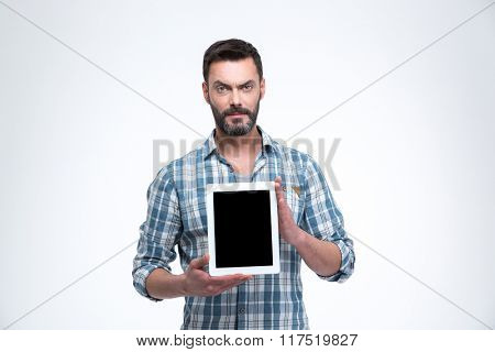 Casual man showing tablet computer screen isolated on a white background