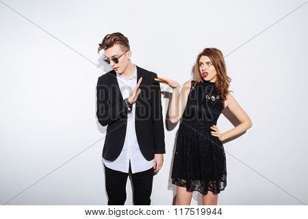 Young couple arguing isolated on a white background