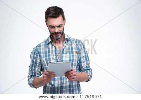 Handsome man using tablet computer isolated on a white background