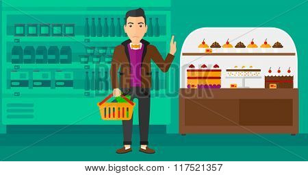 Man holding supermarket basket.