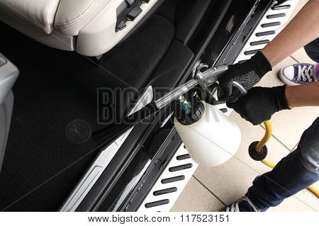 Car Service. Worker Washing Of Interior By A Special Cleaners