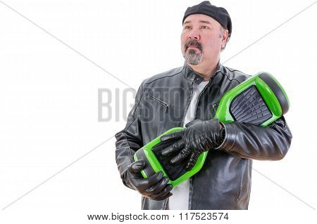 Serious Man In Leather Holding His Hoverboard