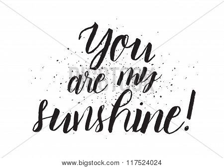 You are my sunshine inscription. Greeting card with calligraphy. Hand drawn design. Black and white.