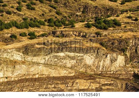Imposing layers of mountain rock cliffs