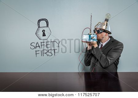 Safety first text with vintage businessman