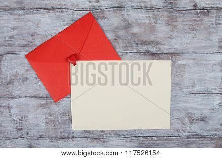 Red envelope and blank paper sheet. Valentine Day image