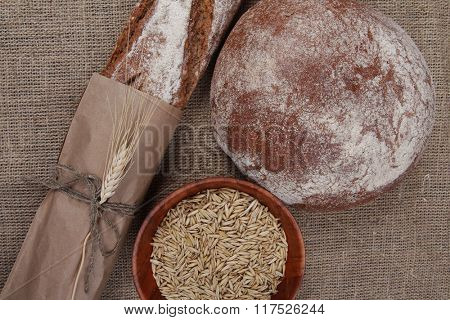 Brown different breads on sackcloth background top view