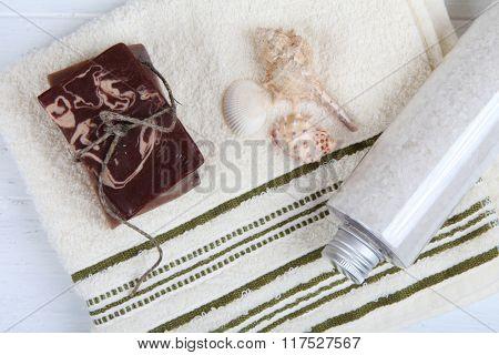 Natural soap and bath salt on towel. Spa treatment