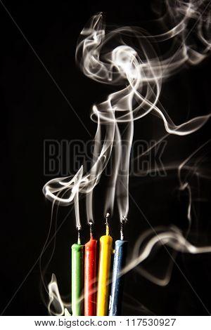Multi-colored Birthday Candles Smoking