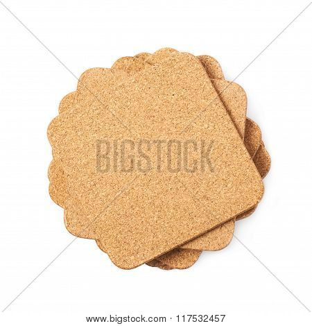 Pile of cork textured coasters isolated