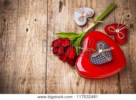Red heart gift valentines day on wooden board