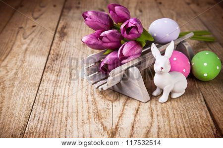 Easter still life with spring flowers and copyspace on wooden board