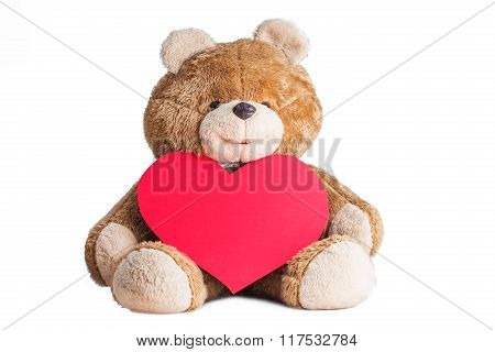 Teddy Bear Holding A Heart On White