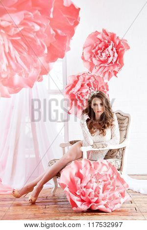 Beautiful Sexy Girl In A Dress With A Huge Pink Flowers Sitting By The Window