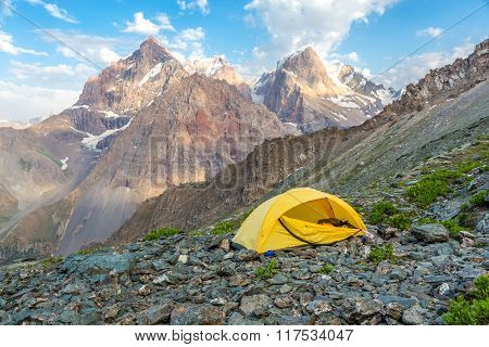 Yellow tent on mountain landscape