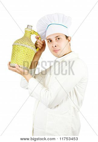 Chef Holding Large Bottle