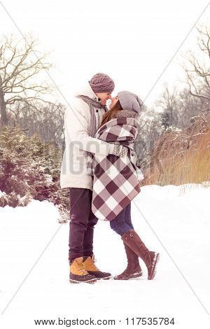 Happy Couple In Love In Park In Winter With Light Leaks