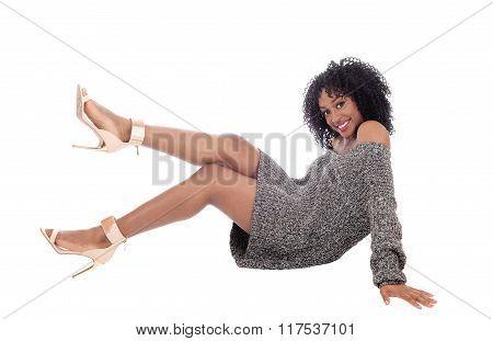 African American Woman Sitting On Floor.