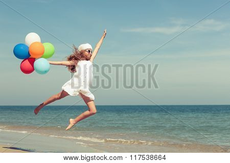 Teen Girl  Jumping On The Beach