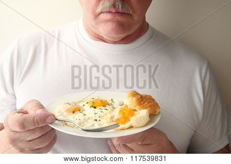 Man With Eggs And Biscuit Breakfast